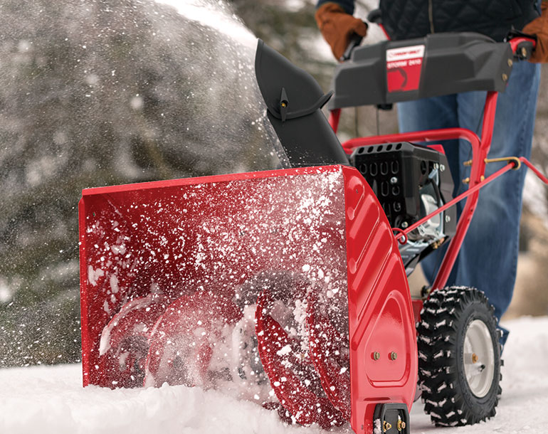 Cleaning snow using a snow blower