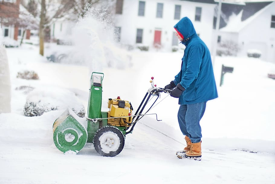 A man using a Snow blower